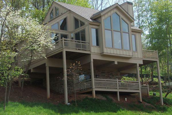 Pedestal Timber Homes & Pedestal Home Kits | Logangate